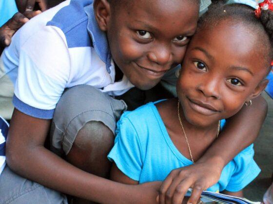 two children embrace in Haiti