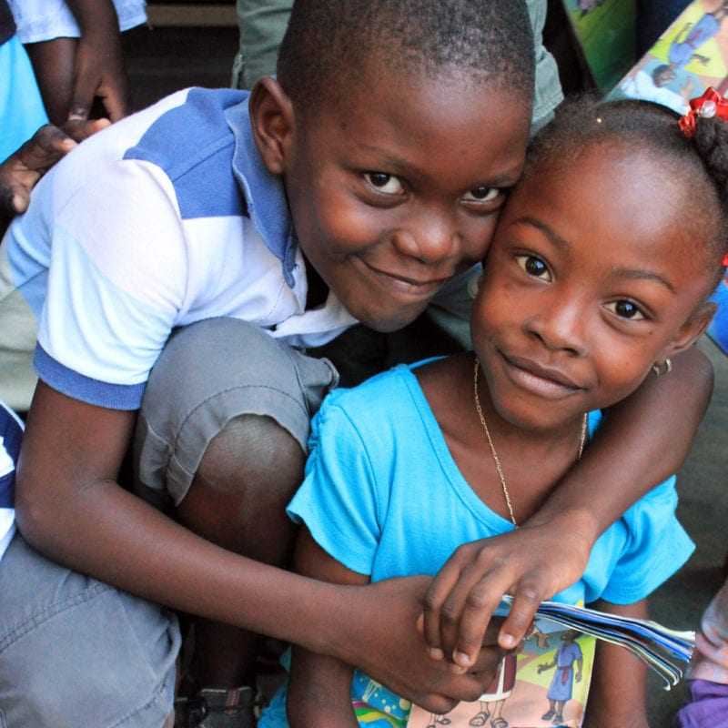 two children embrace in Haiti